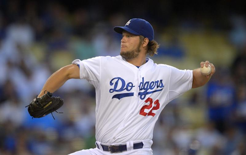Los Angeles Dodgers starting pitcher Clayton Kershaw throws to the plate during the first inning of a baseball game against the Chicago Cubs, Tuesday, Aug. 27, 2013, in Los Angeles. (AP Photo/Mark J. Terrill)