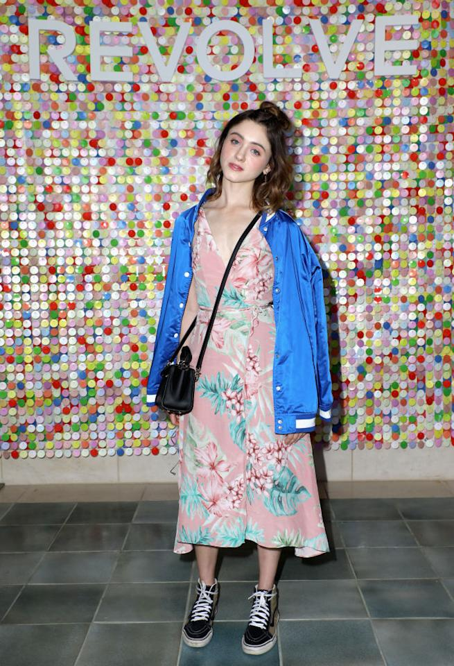 <p>Reason 2,325 for why Natalia Dyer is our go-to style muse this season. The 'Stranger Things' star accessorised a sweet floral number with trainers and a retro bomber. <em>[Photo: Getty]</em> </p>