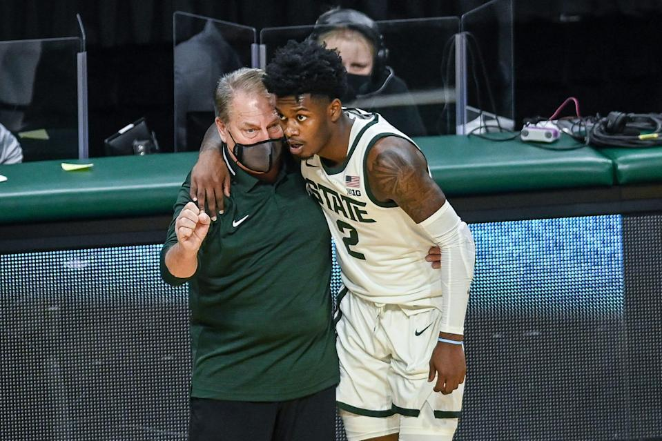 Michigan State's head coach Tom Izzo, left, talks with Rocket Watts during the second half of the game against Detroit Mercy on Friday, Dec. 4, 2020, at the Breslin Center in East Lansing.