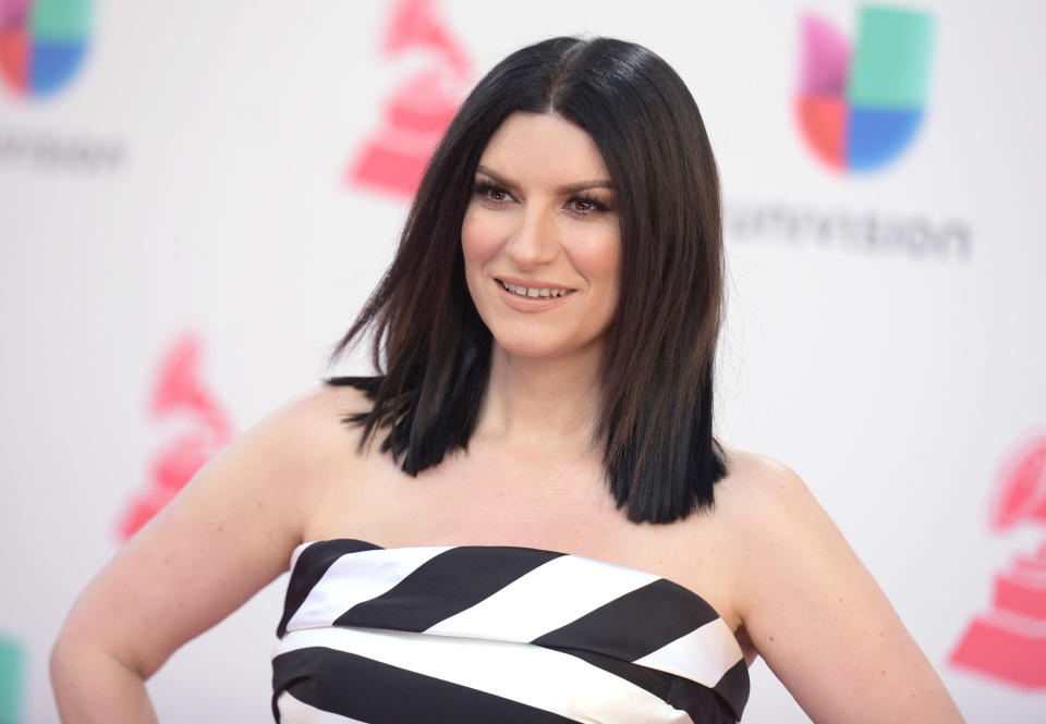 "FILE - In this Nov. 17, 2016 file photo, Laura Pausini arrives at the 17th annual Latin Grammy Awards in Las Vegas. Pausini will perform her Oscar nominated song ""Io Si"" (Seen) from the film ""The Life Ahead."" (Photo by Richard Shotwell/Invision/AP, File)"