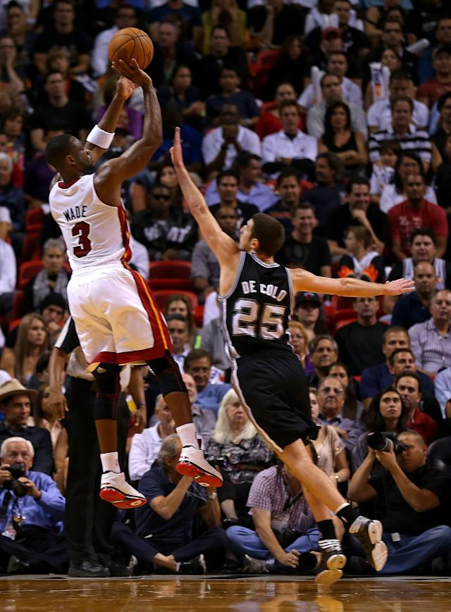 MIAMI, FL - NOVEMBER 29: Dwyane Wade #3 of the Miami Heat shoots over Nando de Colo #25 of the San Antonio Spurs during a game at American Airlines Arena on November 29, 2012 in Miami, Florida. (Photo by Mike Ehrmann/Getty Images)