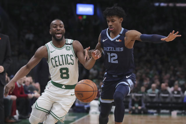 Boston Celtics guard Kemba Walker (8) is fouled by Memphis Grizzlies guard Ja Morant (12) during the second half of an NBA basketball game in Boston, Wednesday, Jan. 22, 2020. (AP Photo/Charles Krupa)
