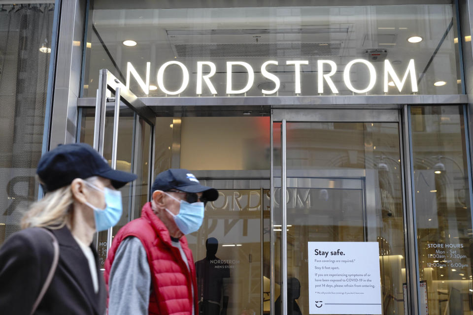 Photo by: John Nacion/STAR MAX/IPx 2020 10/27/20 A view of people with masks on, walking past a Nordstrom Department Store in Midtown. New York City continues Phase 4 of re-opening following restrictions imposed to slow the spread of coronavirus on October 27, 2020 in New York City. The fourth phase allows outdoor arts and entertainment, sporting events without fans and media production.