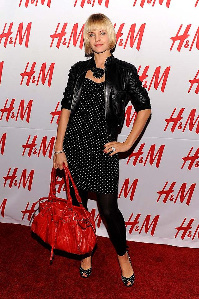 "Mena Suvari unsuccessfully tried to combine too many trends (cropped leather jackets, polka dots, and leggings) into one look. We're not fond of the bob either. Jordan Strauss/<a href=""http://www.wireimage.com"" target=""new"">WireImage.com</a> - November 11, 2008"