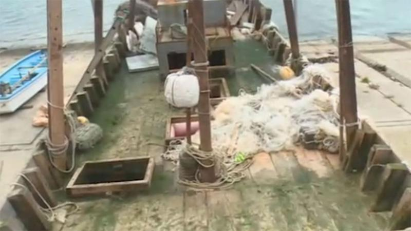 Fishing nets could be seen on this washed up boat. Photo: NHK