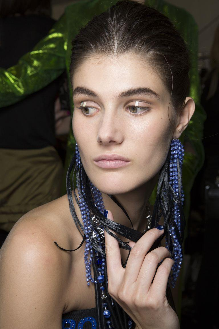 <p>Instead of using a glittery eyeshadow to add a highlight down the center of the eyelid, take a cue from Armani and stick a piece of confetti, instead.</p>