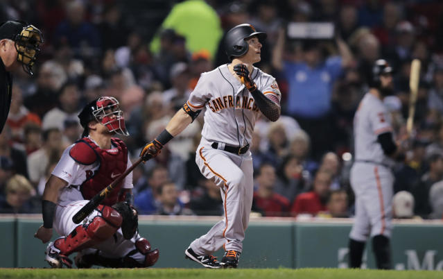 San Francisco Giants' Mike Yastrzemski watches the flight of his solo home run in the fourth inning of a baseball game against the Boston Red Sox at Fenway Park in Boston, Tuesday, Sept. 17, 2019. Yastrzemski is the grandson of Red Sox great and Hall of Famer Carl Yastrzemski. (AP Photo/Charles Krupa)