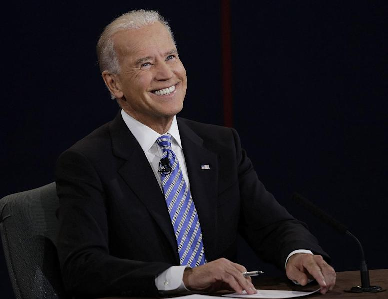 FILE - This Oct. 11, 2012 file photo shows Vice President Joe Biden reacts to a question during the vice presidential debate with Republican vice presidential candidate, Rep. Paul Ryan, R-Wis., at Centre College in Danville, Ky. Campaign 2012 is rich with images that conjure the seriousness and silliness that unfold side-by-side in any presidential race. The debates offered viewers a collage of images that traced the rhetorical highs and lows. Think of Obama's downcast eyes and pursed lips during the Romney smackdown that was the first debate. (AP Photo/Charlie Neibergall, File)