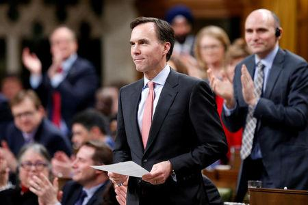 FILE PHOTO --  Canada's Finance Minister Morneau receives a standing ovation in the House of Commons in Ottawa