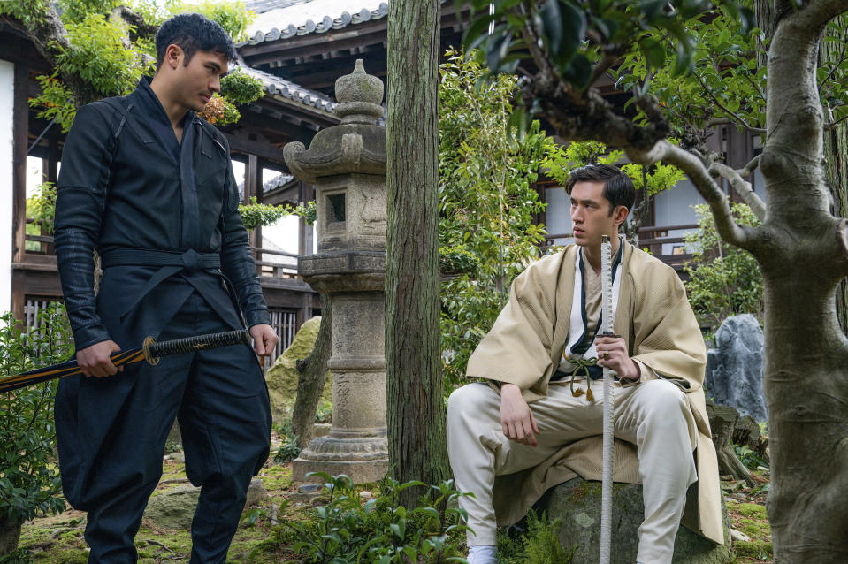 """This image released by Paramount Pictures shows Henry Golding and Andrew Koji in a scene from """"Snake Eyes: G.I. Joe Origins."""" (Niko Tavernise/Paramount Pictures via AP)"""