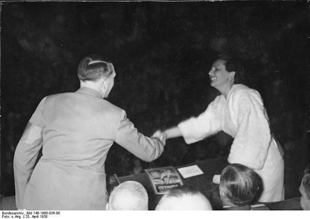 "<span class=""caption"">Leni Riefenstahl and Adolf Hitler in 1938 at the premiere of her first Olympia movie.</span> <span class=""attribution""><span class=""source"">Bundesarchiv/Wikimedia</span></span>"