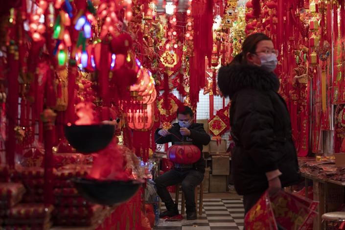 Decorations for the Chinese New Year hang in a store in Wuhan.