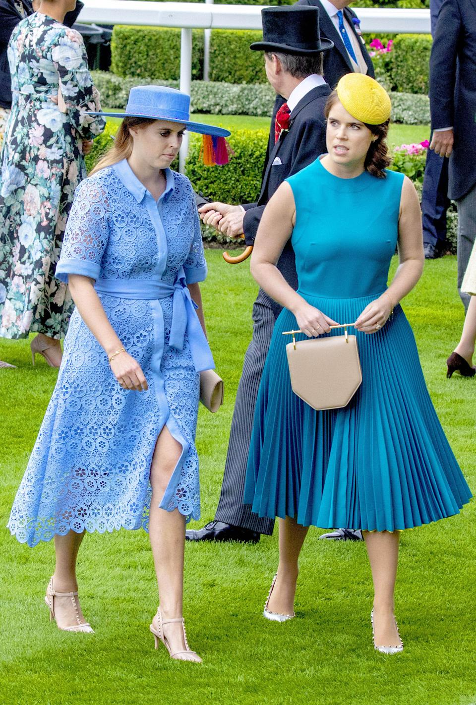 <p>Blue is a favourite of royal ladies at Ascot, and both Eugenie and Beatrice wore shades of it in 2019. Beatrice might want to check with Kate before she wears this dress - which was strikingly similar to the Duchess of Cambridge's top and skirt pictured earlier. (PPE/Nieboer/Sipa USA)</p>