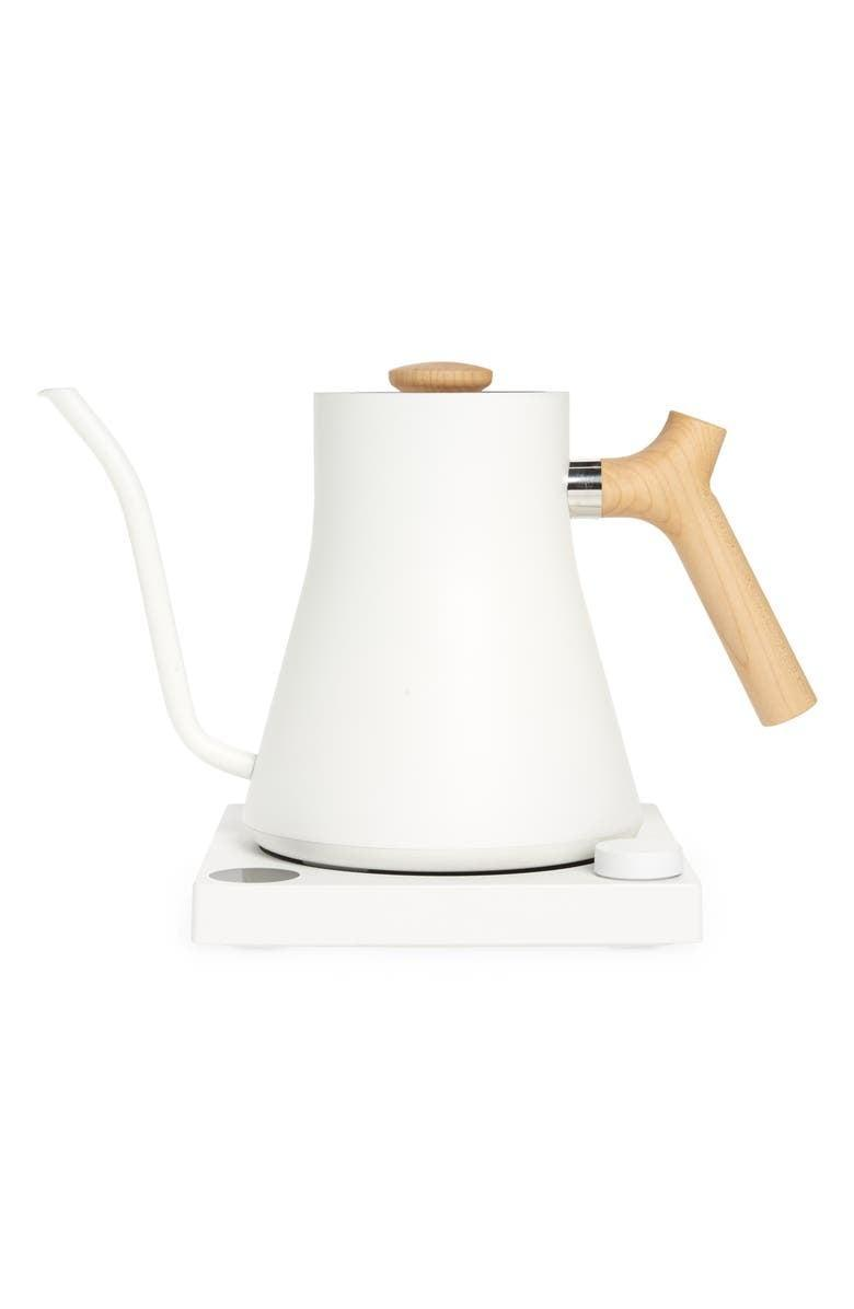 <p>If you like white accent pieces in your kitchen, then get the <span>Fellow Stagg EKG Electric Kettle</span> ($169). The maple wood accent handle makes it look so chic.</p>