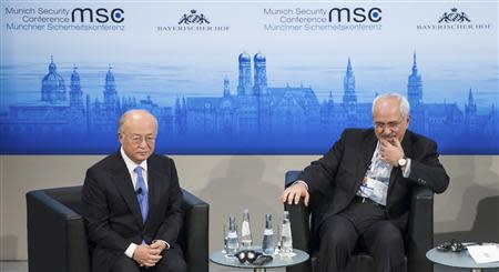 International Atomic Energy Agency (IAEA) Director General Yukiya Amano (L) and Iran's Foreign Minister Mohammad Javad Zarif attend the annual Munich Security Conference February 2, 2014. REUTERS/Lukas Barth