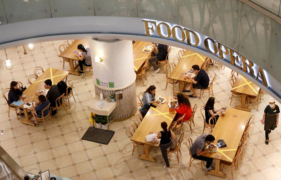 Tables and chairs are taped up to encourage social distancing, due to the outbreak of the coronavirus disease (COVID-19), at a food court in Singapore March 25, 2020. REUTERS/Edgar Su