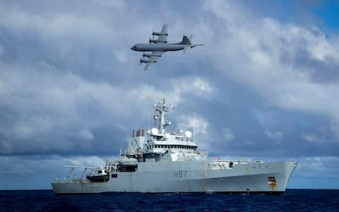 Survey ship HMS Echo and a Lockheed P-3 Orion during the early days of the search in the southern Indian Ocean - Credit: Press Association