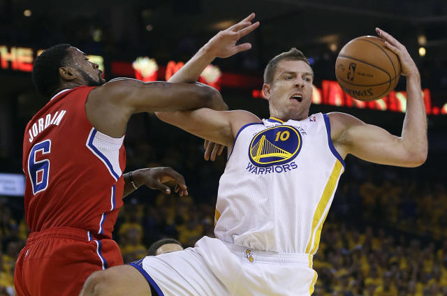 Golden State Warriors power forward David Lee (10) grabs the ball next to Los Angeles Clippers center DeAndre Jordan (6) during the first quarter of Game 6 of an opening-round NBA basketball playoff series in Oakland, Calif., Thursday, May 1, 2014. (AP Photo/Marcio Jose Sanchez)