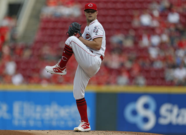 Cincinnati Reds starting pitcher Sonny Gray throws against the Milwaukee Brewers during the first inning of a baseball game, Wednesday, July 3, 2019, in Cincinnati. (AP Photo/Gary Landers)