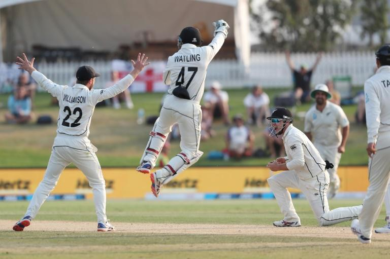 New Zealand's Tom Latham (R) celebrates the wicket of England's Jack Leach during the fourth day of the first cricket Test between England and New Zealand at Bay Oval in Mount Maunganui on November 24, 2019