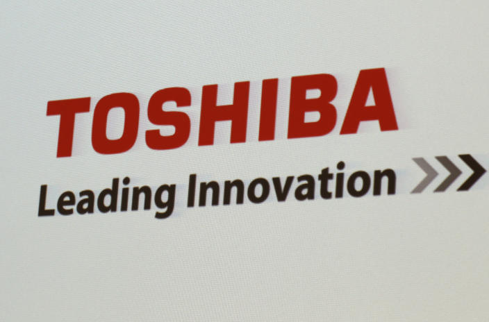 "FILE - In this June 15, 2017, file photo, the logo of Toshiba Corp., Japan's electronics and energy company, is seen on a screen during a press conference in Yokosuka, near Tokyo. Trading in Toshiba stock was halted Wednesday, April 7, 2021 after the Tokyo-based technology conglomerate confirmed it had received a preliminary acquisition proposal. Toshiba Corp. said Tuesday, April 6 it had asked for more details on the proposal, was giving it ""careful consideration"" and would make an announcement ""in due course."" (AP Photo/Shuji Kajiyama)"