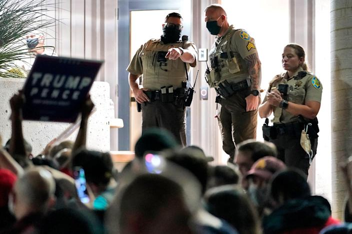 Maricopa County Sheriff's Deputies stand at the door of the Maricopa County Recorder's Office as President Donald Trump supporters rally outside, Wednesday, Nov. 4, 2020, in Phoenix. (AP Photo/Matt York) (AP)