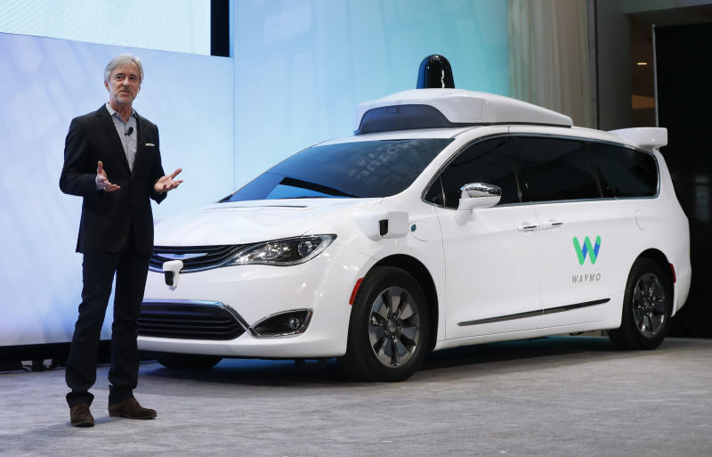 FILE - In this Sunday, Jan. 8, 2017, file photo, John Krafcik, CEO of Waymo, the autonomous vehicle company created by Google's parent company, Alphabet, introduces a Chrysler Pacifica hybrid outfitted with Waymo's own suite of sensors and radar, at the North American International Auto Show in Detroit. At the show, Waymo reiterated that it doesn't plan to make its own cars, but wants to partner with established auto companies and others. (AP Photo/Paul Sancya, File)