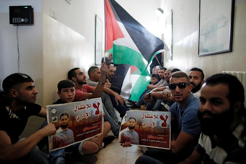 Palestinians occupy the Red Cross headquarters in East Jerusalem on August 16, 2015, in solidarity with Palestinian prisoner Mohammed Allan (AFP Photo/Ahmad Gharabli)