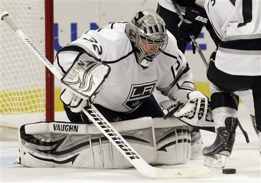 Los Angeles Kings goalie Jonathan Quick makes the save on a shot by Chicago Blackhawks' Patrick Sharp during the second period of an NHL hockey game in Chicago on Wednesday, Dec. 28, 2011. (AP Photo/Nam Y. Huh)