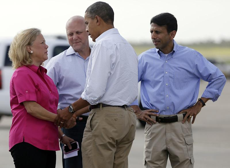 President Barack Obama, center, is greeted on the tarmac by from left to right, Sen. Mary Landrieu, D-La., New Orleans Mayor Mitch Landrieu, and Gov. Bobby Jindal, during his arrival at Louis Armstrong New Orleans International Airport, Monday, Sept. 3, 2012, in Kenner, La. Obama traveled to the region to view the ongoing response and recovery efforts to Hurricane Isaac. (AP Photo/Pablo Martinez Monsivais)