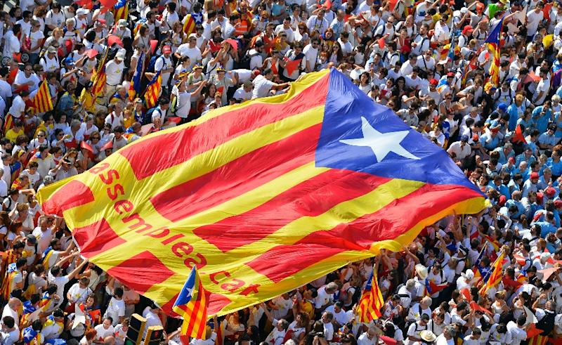 Catalonia's 'Diada' national day is a showcase of breakaway sentiment: In 2015, marchers formed into the shape of an arrow and unfolded a huge pro-independence flag known as the Estelada (AFP Photo/GERARD JULIEN)