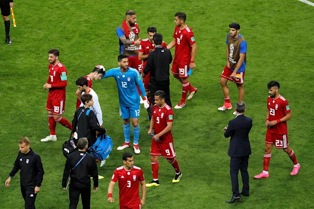 Soccer Football - World Cup - Group B - Iran vs Spain - Kazan Arena, Kazan, Russia - June 20, 2018 Iran's Mohammad Rashid Mazaheri and team mates look dejected after the match REUTERS/John Sibley