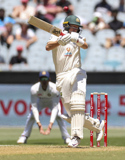 Australia's Marnus Labuschagne reacts as he is hit in the helmet while batting during play on day one of the Boxing Day cricket test between India and Australia at the Melbourne Cricket Ground, Melbourne, Australia, Saturday, Dec. 26, 2020. (AP Photo/Asanka Brendon Ratnayake)