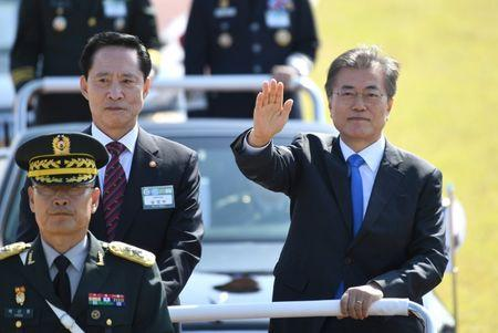South Korean President Moon and Defense Minister Song review the troops during a commemoration ceremony marking South Korea's Armed Forces Day