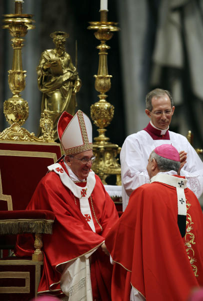 Monsignor Mario Aurelio Poli, Archbishop of Buenos Aires, Argentina, is greeted by Pope Francis after receiving the Pallium, a woolen shawl symbolizing his bond to the pope, during a mass in St. Peter's Basilica, at the Vatican, Saturday, June 29, 2013. (AP Photo/Gregorio Borgia)