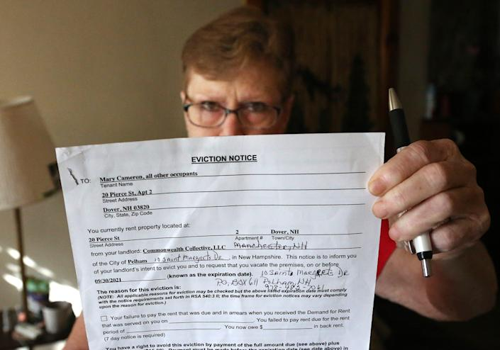 Dover resident Mary Cameron holds up the eviction notice she received Aug. 1 after being a tenant for seven years in an apartment at 20 Pierce St. She spoke about her situation on  Tuesday, Sept.14, 2021.