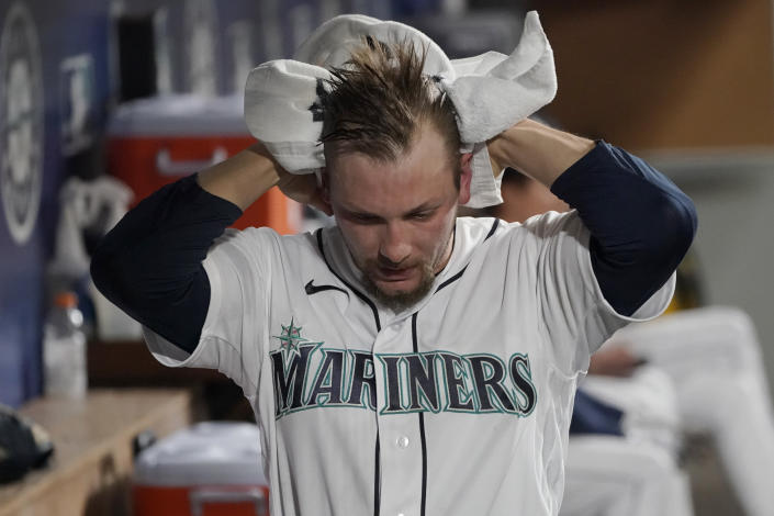 Seattle Mariners pitcher Anthony Misiewicz reacts in the dugout after he was pulled during the eighth inning of a baseball game against the Baltimore Orioles, Monday, May 3, 2021, in Seattle. (AP Photo/Ted S. Warren)