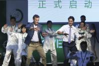 Canadian Prime Minister Justin Trudeau performs tai chi with a group in Shanghai, China, on Sept. 2, 2016. Chinatopix via The Associated Press