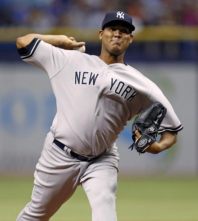New York Yankees starting pitcher Ivan Nova throws during the first inning of a baseball game against the Tampa Bay Rays, Saturday, April 19, 2014, in St. Petersburg, Fla. (AP Photo/Mike Carlson)