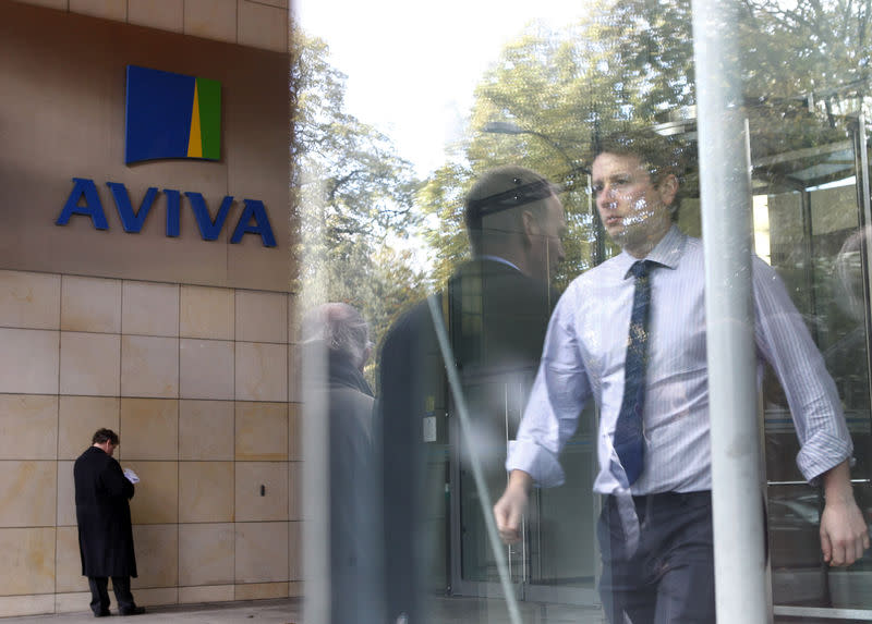 FILE PHOTO - People enter and exit the AVIVA headquarters building in Dublin.