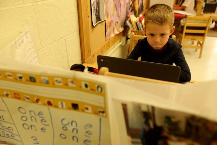 Kindergarten student Bobby, 6, works on his computer while attending class at Kigala Preschool in Santa Monica.