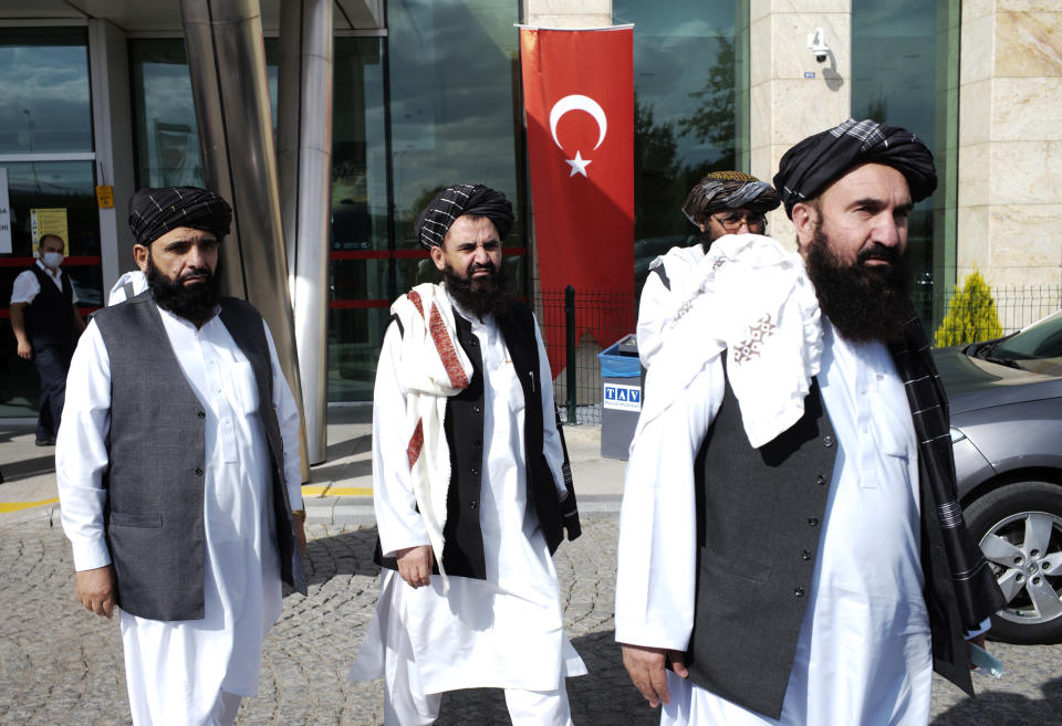 The Taliban delegation led by Amir Khan Muttaqi, the acting foreign minister, not pictured, walk at Esenboga Airport, in Ankara, Turkey, Thursday, Oct. 14, 2021. A high-level delegation of Afghanistan's new Taliban rulers has arrived in Turkey for talks with Turkish officials, the Foreign Ministry announced Thursday. The meetings in the capital of Ankara would be first between the Taliban and senior Turkish government officials after the group seized control of Afghanistan. (AP Photo/Burhan Ozbilici)