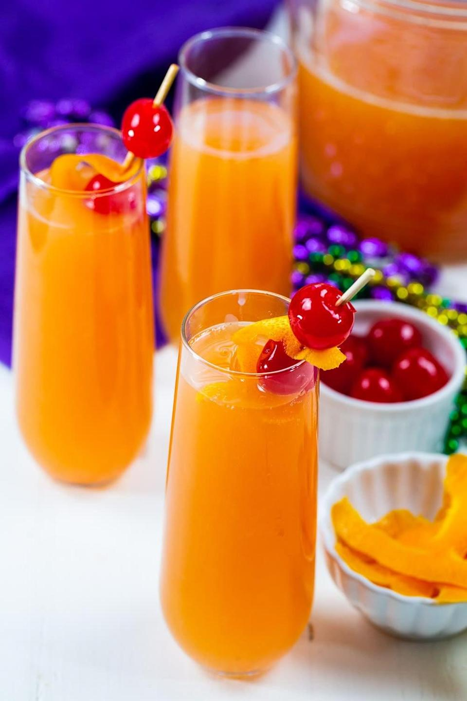 """<p>Kick off Mardi Gras the right when you whip up these hurricane mimosas. Complete with rum, passion fruit juice, grenadine, orange juice, and champagne, these are sure to get the party started. Just add beads!</p> <p><strong>Get the recipe</strong>: <a href=""""https://spicysouthernkitchen.com/hurricane-mimosas/"""" class=""""link rapid-noclick-resp"""" rel=""""nofollow noopener"""" target=""""_blank"""" data-ylk=""""slk:hurricane mimosas"""">hurricane mimosas</a></p>"""