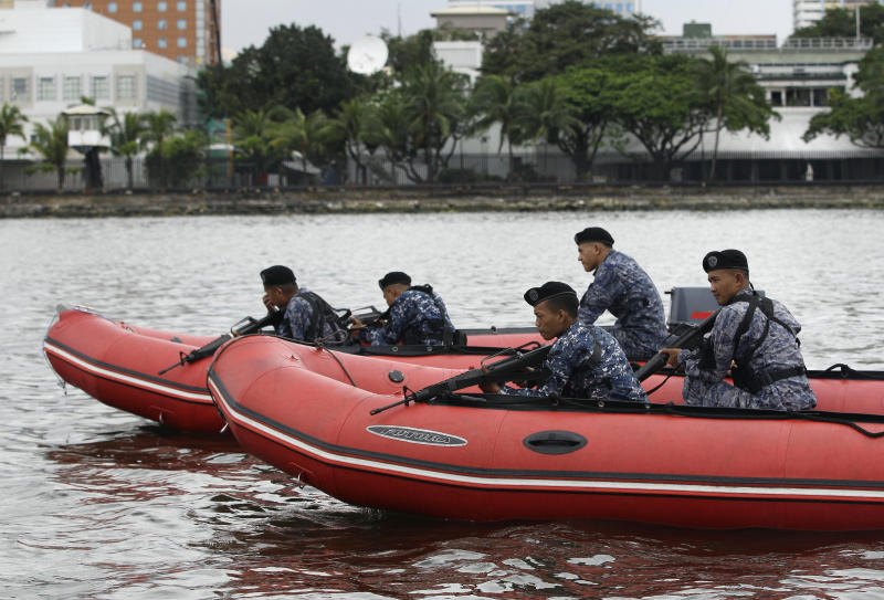 Members of the Philippine Coast guard anti-terrorist unit conduct a maritime patrol at the back of the U.S. Embassy in Manila, Philippines on Thursday Sept. 13, 2012. Security was increased at U.S. embassies and consulates around the world following an attack that killed a U.S. ambassador in Libya. (AP Photo/Aaron Favila)
