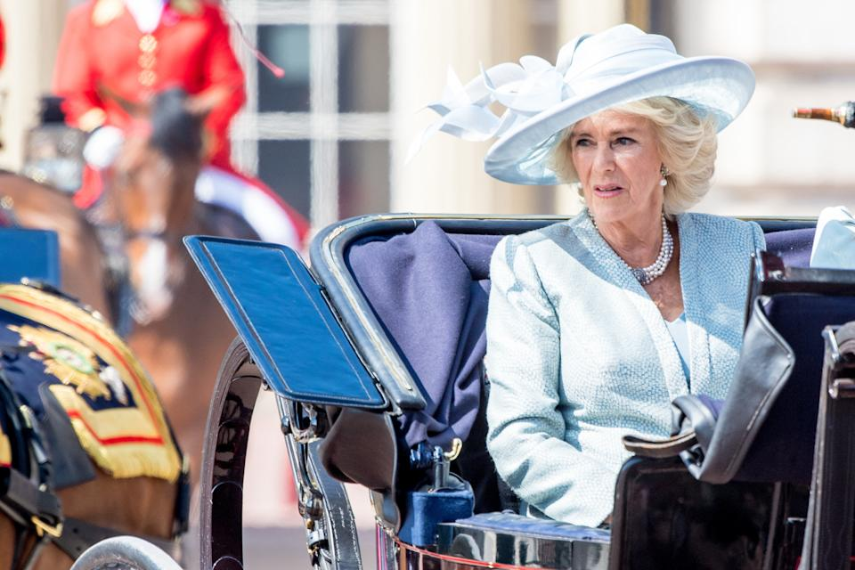 Camilla, Duchess of Cornwall wore a dusty light blue Bruce Oldfield coat and dress with a Philip Treacy hat, with her four-strand pearl and diamond clasp necklace. (PA Images)
