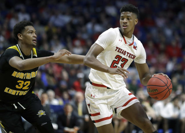 Texas Tech's Jarrett Culver (23) heads to the basket past Northern Kentucky's Dantez Walton (32) during the second half of a first round men's college basketball game in the NCAA Tournament Friday, March 22, 2019, in Tulsa, Okla. Texas Tech won 72-57. (AP Photo/Jeff Roberson)