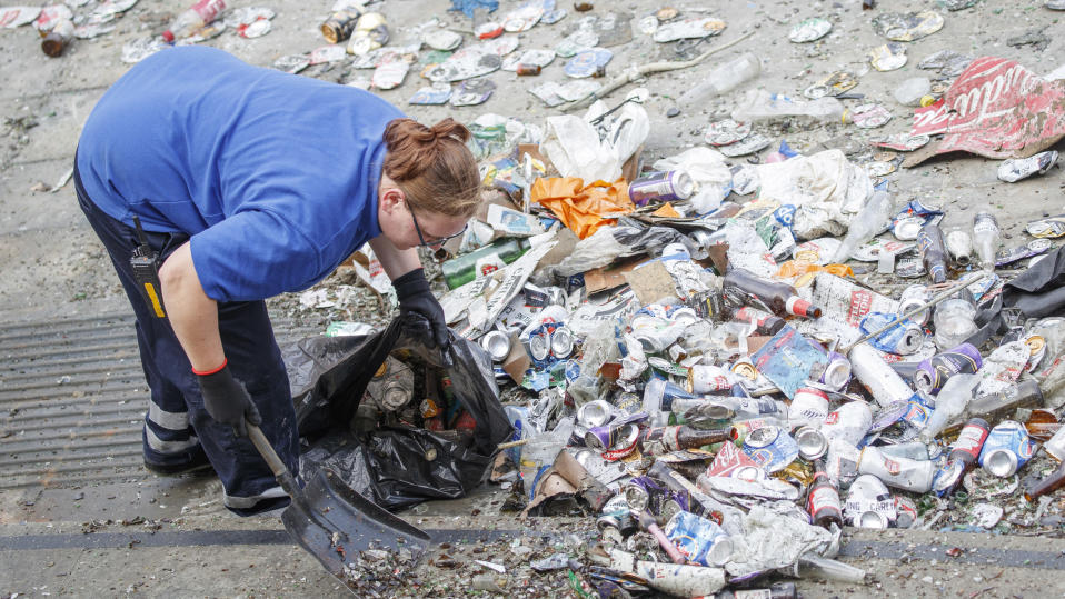 Leeds fans, pictured here leaving rubbish strewn throughout the streets.