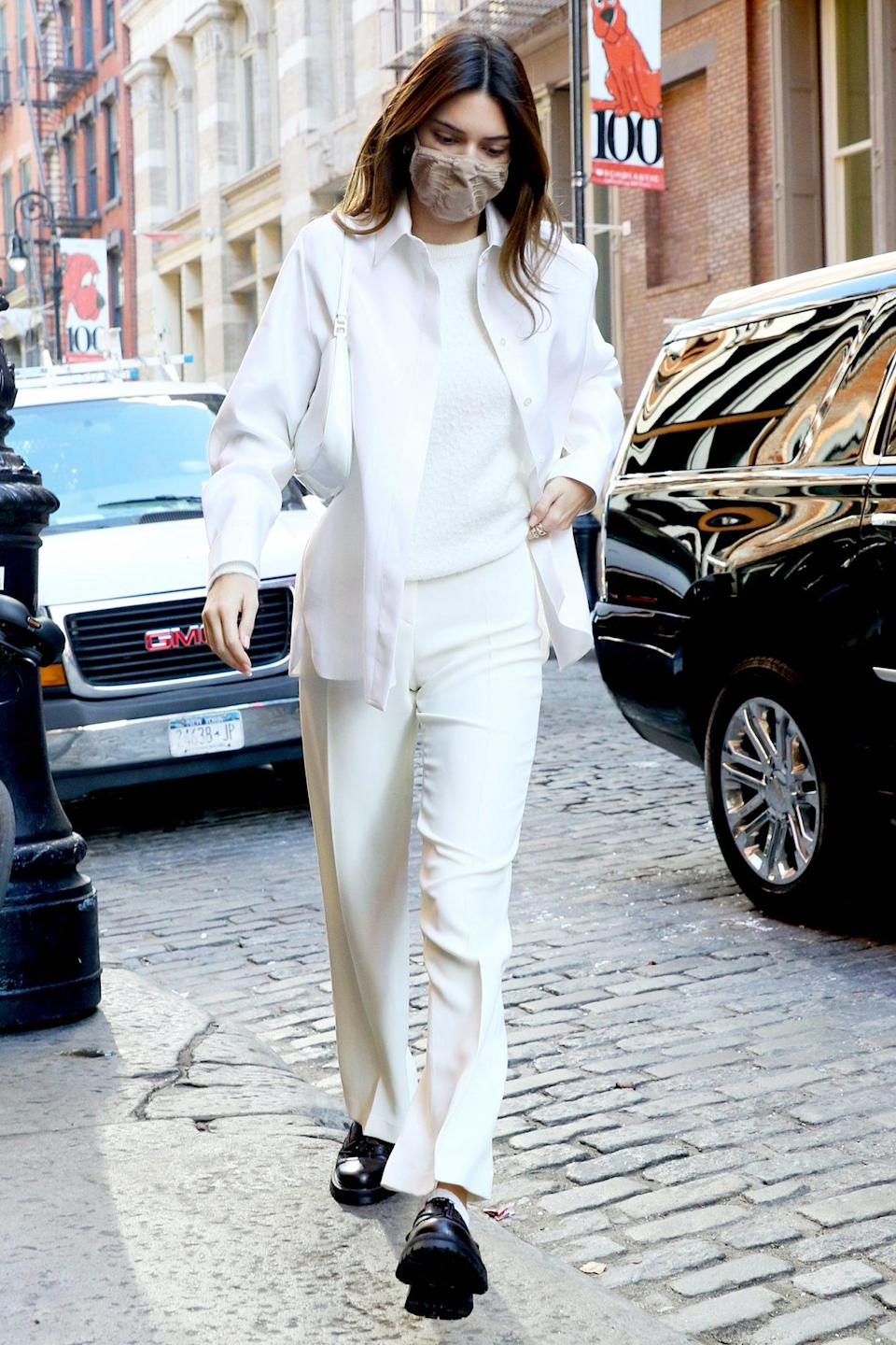 """<p>Kendall Jenner eschews the """"no white after Labor Day"""" rule while out and about in N.Y.C. on Sunday. </p>"""