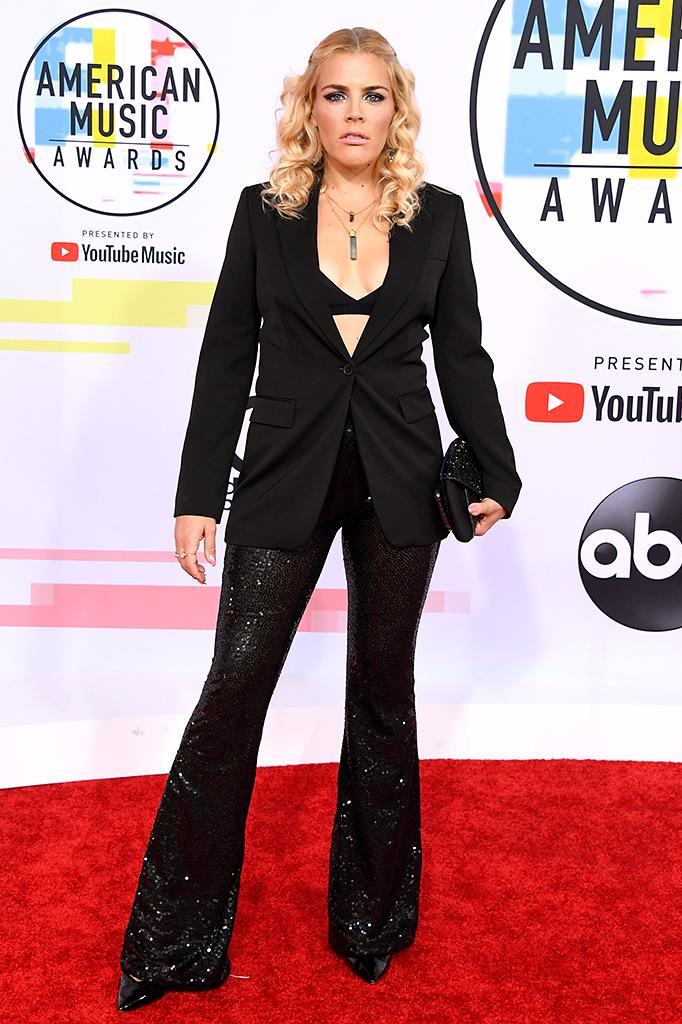 <p>Busy Philipps, host of the upcoming show <i>Busy Tonight</i>, sported a glammed up version of a suit, with sequined pants and a bra top. (Photo: Jon Kopaloff/FilmMagic) </p>