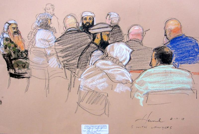 """In this pool photo of a sketch by courtroom artist Janet Hamlin and reviewed by the U.S. Department of Defense, the five co-conspirators accused of the Sept. 11 attacks, Khalid Sheikh Mohammed, far left, Walid bin Attash, second from left, Ramzi Binalshibh, fifth from left, Ammar al Baluchi, center, and Mustafa Ahmad al-Hawsawi, fourth from right, confer with their defense lawyers during the pre-trial hearing of their death penalty cases at the Guantanamo Bay U.S. Naval Base in Cuba, Monday, Feb. 11, 2013. A senior official for the Guantanamo Bay prison said under questioning Tuesday that the government had placed a hidden microphone inside a meeting room but that he was assured it was not used to monitor the private conversations that prisoners have with their lawyers and the Red Cross. Navy Capt. Thomas Welsh, the senior legal adviser to the commander of the Guantanamo Bay prison, conceded the microphone appeared to be intended to resemble a smoke detector in the ceiling of a meeting room for men labeled """"high-value"""" detainees by the Pentagon and held in a special top security camp at the U.S. base in Cuba. (AP Photo/Janet Hamlin, Pool)"""